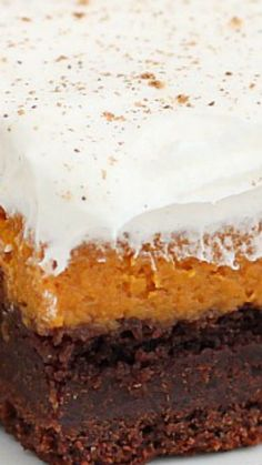 Chocolate Pumpkin Bars ~ Perfect for fall potlucks, these chocolate pumpkin bars feature layers or rich chocolate cake, silky pumpkin pie and light frosting