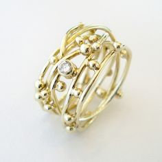 """""""Threads of life"""" ring with a diamond. www.hoogenboombogers.com"""