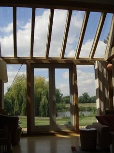 View through glazed green oak wall and roof in house overlooking upper reaches of River Thames by Roderick James Architects. Timber Architecture, Architecture Design, Glass Porch, Glass Roof, Glass Extension, Extension Ideas, Barn With Living Quarters, Oak Framed Buildings, Crazy Houses