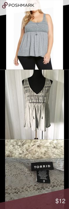 Babydoll Lace and Knit Tank Top by Torrid 3 (3X) Babydoll style tank top by Torrid.  Grey color.  Top is Lace bottom is Knit.  Size 3 (3X).  Good condition.  Important:   All items are freshly laundered as applicable prior to shipping (new items and shoes excluded).  Not all my items are from pet/smoke free homes.  Price is reduced to reflect this!   Thank you for looking! torrid Tops Blouses
