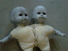 Thrift shop dolls reworked -- so creepy  I only like this because it would freak out my husband