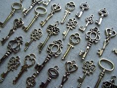 key charms. Oooh, I have always been fascinated by antique-looking keys. ;-)