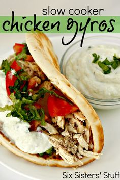 Slow Cooker Chicken Gyros - 1 lb boneless, skinless chicken breasts 3 cloves garlic, minced 1/4 cup fresh lemon juice 1 onion, diced 1/4 cup water 1 tablespon olive oil 2 Tablespoons red wine vinegar 1 teaspoon oregano 1/4 teaspoon allspice 1 teaspoon lemon pepper