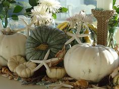 Fall comes to the beach. I like the pumpkins and starfish...maybe different flowers tho.