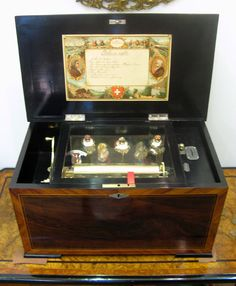 Takes an English penny. Box made of Rosewood with Kingwood banding Antique Music Box, Antique Boxes, Valentines For Boys, Valentine Box, Vintage Slot Machines, Dancing Dolls, Vending Machines, Music Boxes, Best Memories