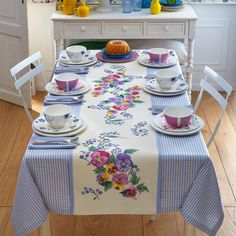 Ivory and lavender chequered cotton tablecloth with simple hem and ivory aida central insert to be cross-stitched.