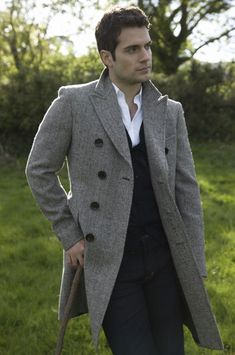 Classy tweed trench and suit without tie. Well played, #HenryCavill