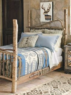 Four-poster Birch Bed, pretty.  I have a pendleton blanket in the guest room already that is just like that one.