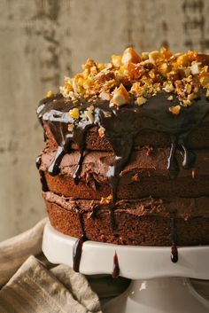 Cupcakes & Couscous: Vegan Chocolate Nut Brittle Cake - 3 layers of chocolate cake sandwiched together with chocolate icing and topped with chocolate sauce and almond and pecan brittle. Dairy and egg free!
