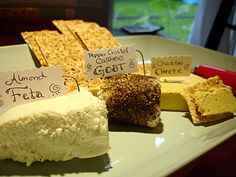 3 Vegan Cheeses: Cheddar Cheese, Pepper Crusted Cashew Goat Cheese, Almond Feta Cheese.