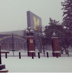 The Big House in the snow. Check out this picture on our Instagram @uofmichigan