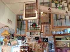 Stained glass windows.The Elegant Attic, Buxton NC. The shop's main feature is a spectacular selection of antique stained-glass windows and doors imported from England.