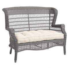 A comfy, traditional outdoor settee with open-air back, hand-woven construction, fully wrapped legs and rich textures. It's a durable, versatile look for your patio or porch. The finishing touch: One of our pretty outdoor cushions, available separately.