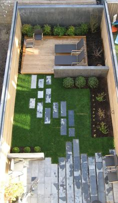 16 Inspirational Backyard Landscape Designs As Seen From Above // Although this backyard is small it still manages to get three defined spaces - a lounge, a grassy area, and a patio right off the house.