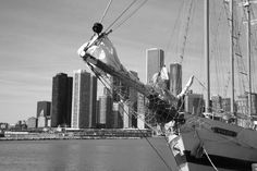 Chicago Skyline. Tall sailing ship on Lake Michigan with Chicago buildings in background. A real sail boat perfect for a windy city.