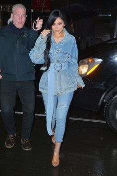 Kylie Jenner while heading to and from fashion shows in New York, Kylie Jenner wore a full denim look - from her coat, to her skinny jeans and her oversized belt. We told you she's brave. #fashion #style #outfit