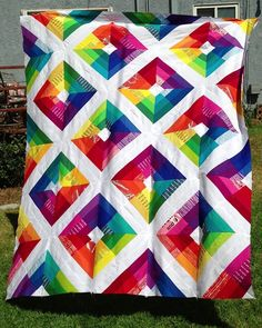 free download at Robert Kaufman.  This one is the 2.5″ Roll-up version and with the added text strips, it measures 70″x 84″ with one block left over to make a pillow.  If you want yours to be this size, you just need to start with 16 strip sets, instead of 13.