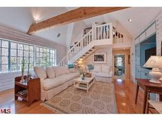 Kate Hudson's family room, stairs, blue built in