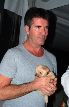 ''When you see a picture of Uncle Simon holding a puppy you do not keep scrolling you repin the picture''  HAHAHAHA