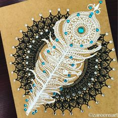 Feather journal adorned with white and blue crystals. Mandala Drawings on Journals Calendar and Boxes. By Zareen Taj Hidhayath.