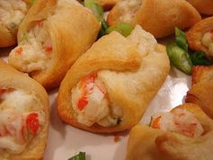 Crab Filled Crescent Roll Appetizers: 1-8 oz. tube crescent roll dough  3 oz. cream cheese, softened  1/4 cup mayonnaise  3/4 cup cooked crabmeat, chopped  2 green onions, chopped  1/8- 1/4 teaspoon cayenne pepper  salt and pepper, to taste