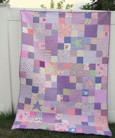 """I like the pattern that she used and the """"showcase"""" pieces that are interspersed throughout.  A Very Purple-y Quilt (from Diary of a Quilter)"""