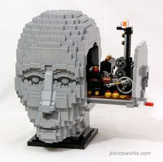 https://flic.kr/p/GkVUKw | The Engineer | This is Kristal's latest model, a sculpture of a human head the opens up to reveal what's inside the mind of a LEGO engineer.  Video showing it in action and explaining how it works: youtu.be/RtGZ_0Gb86w  More pics and info: jkbrickworks.com/the-engineer  Follow me: Facebook | Google+ | Twitter | Instagram