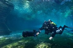 Photographer: David Oldham. Site: Ginnie Springs, FL Revo rebreather diver with Silent sub scooter