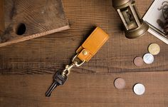 Italian leather go with high-quality bronze hardware, muiti-function Keychain, mobile phone stand & cable retractor. Phone Stand, Leather Keychain, Italian Leather, Cable, Hardware, Bronze, Personalized Items, Cabo, Leather Key Holder