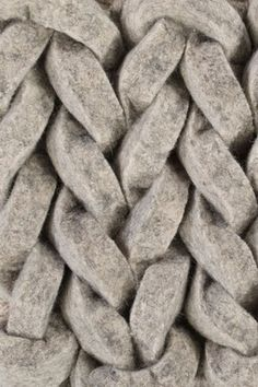 Oversized knitted textiles with braided patterns & chunky wool textures