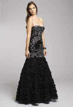 """Exude all that is chic in this high fashion strapless long dress by Jovani. At one glance of this true beauty, we envision """"Parisian chic"""" as it's style is quite reminiscent of a haute couture dress. Design elements of this dress include a fully beaded bodice combined with a full soutache skirt for an added stunning quality. It's the perfect finishing touch for a look that emanates red carpet style. Couple this dress with amazing accessories like a pair of black platform sandals, a rhines..."""