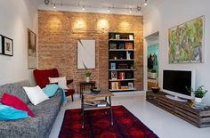 Love the rustic elements of the exposed brick and apple crate tv console mixed with contemporary style.