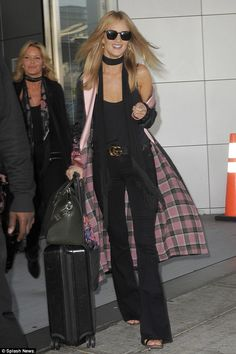The ultimate jet-setter: Rosie Huntington-Whiteley looked as glamorous as ever after her e...