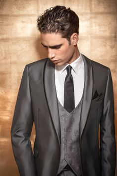 The rounded lapels on this suit, along with the clean, patterned vest look amazing.