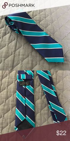 J.Crew Silk Skinny Tie Like new condition only worn a few times! Navy and aqua stripe with thinner silver stripe. It's a skinny tie about 2.5 inches wide. J. Crew Accessories Ties