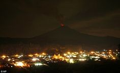 The mexican town of Xanilitzintia with the Popocatepeti volcano looming above, spewing lava, ash and steam... 2/21/12