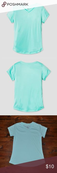 New CHAMPION Girls Sea Green Tech T-Shirt The Girl's Tech t-shirt from C9 Champion® helps keep you cool and comfortable with fast-drying, wicking fabric that blocks harmful rays with at least 15 UPF protection.  size M (7-8) new without tags color: sea green  Duo Dry+™ technology wicks moisture and dries fast Fabric blocks harmful rays with at least 15 UPF protection Semi-fitted  @cjrose25  More kids clothes in my posh closet. Bundle your likes for a discount & save on shipping. Champion…