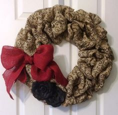 Black Filigree Stamped Burlap Wreath with Red Burlap Bow and Faux Flowers by KatiesSpecialTouch on Etsy
