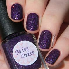 A deep plum purple base with a variety of silver holographic glitters.  Handmade and 5 Free! Polish comes in a 12mL bottle.