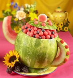Food Art: Tea Pot 1 Round seedless watermelon Small round cookie cutter Melon baller Paring and kitchen knives Toothpicks :