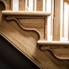 Hand crafted stairs with carved stair brackets