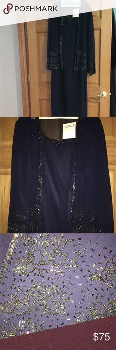 Gorgeous formal navy dress with beading detail This dress is just gorgeous. It is navy in color with beautiful beading detail. It has a sheer jacket that has the same beading detail. It has a slit in the back of the dress shown in one of the pictures. Dresses Maxi