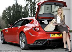 Pooch perfect: Miss UK Kirsty Heslewod and friend with the Ferrari FF. Could this be the u...