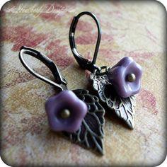 Eden: czech glass flower and brass leaf beaded earrings. $8.50, via Etsy.