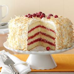 Cranberry Coconut Cake with Marshmallow Cream Frosting Recipe -Filled with a homemade cranberry curd and smothered with one of the fluffiest frostings you've ever had, this tall cake will make a memorable impression at any holiday gathering. —Julie Merriman, Cold Brook, New York