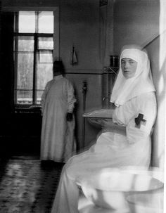 "Grand Duchess Olga Nikolaevna Romanova of Russia resting during a break from duties as a Sister of Mercy during WWl. ""AL"""