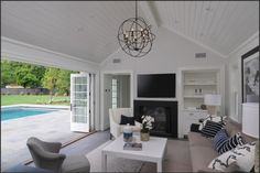 love this pool house with pocket doors and high ceiling
