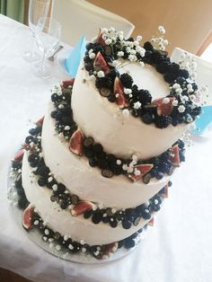 Wedding cake with blueberries, blackberries, flower and figs
