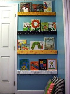 DIY Gutter Book Display - custom covered, found space behind the door. Gutter Bookshelf, Bookshelf Wall, Corner Bookshelves, Wall Shelves, Diy Gutters, Book Wall, Wall Nook, Kids Storage, Do It Yourself Home
