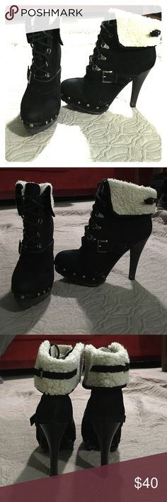 Black booties with faux white fur Black heeled booties with white faux fur. Used but in good conditions. Baby Phat Shoes Ankle Boots & Booties